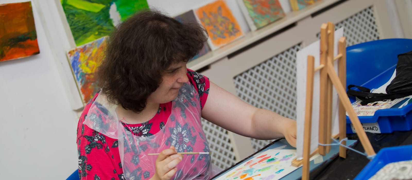 an acorns day services service user enjoys an arts and crafts activity